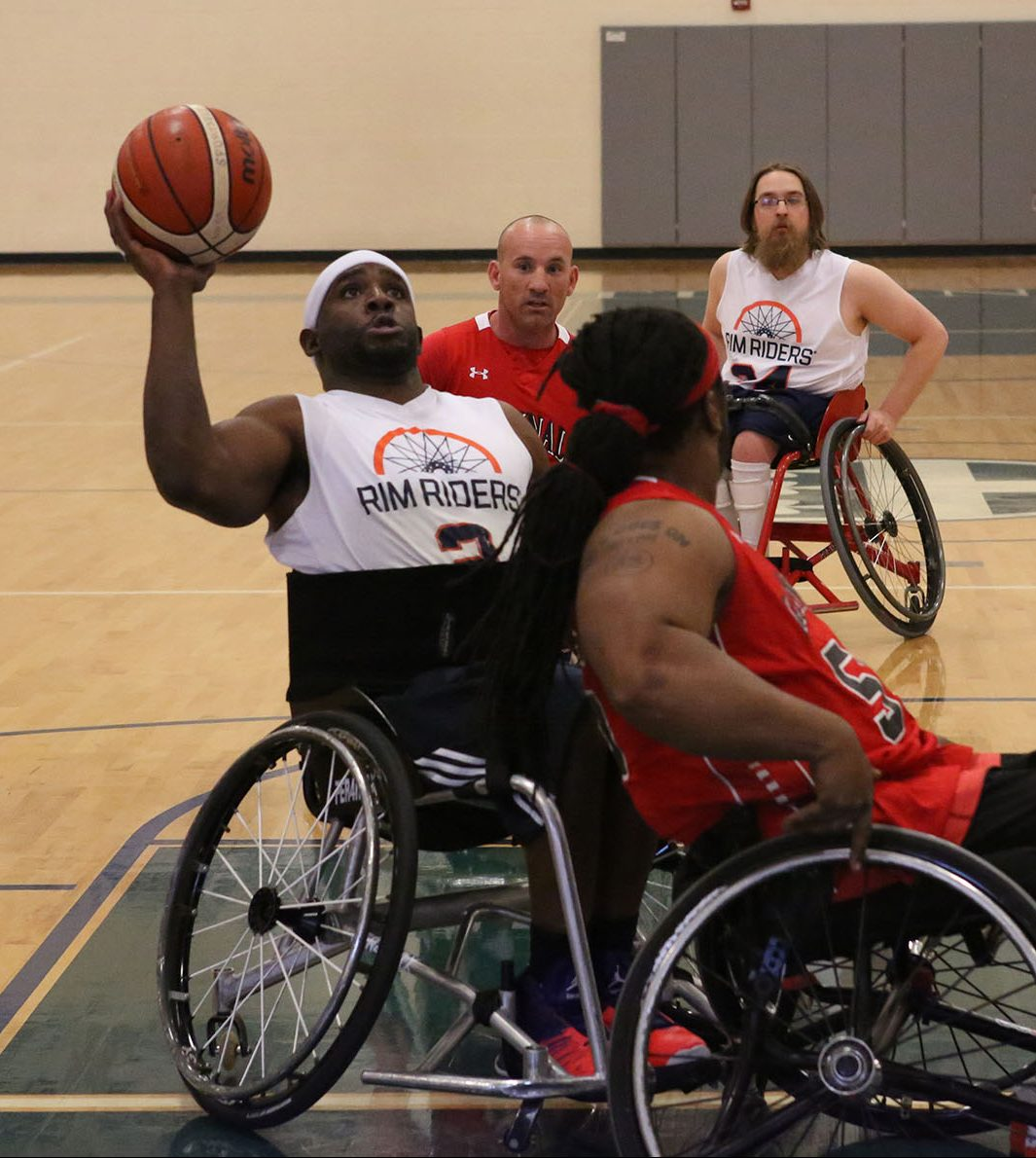Wheelchair basketball cover art - players playing.
