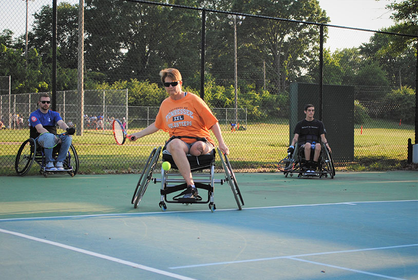 Adult tennis cover art - adult in wheelchair playing tennis.
