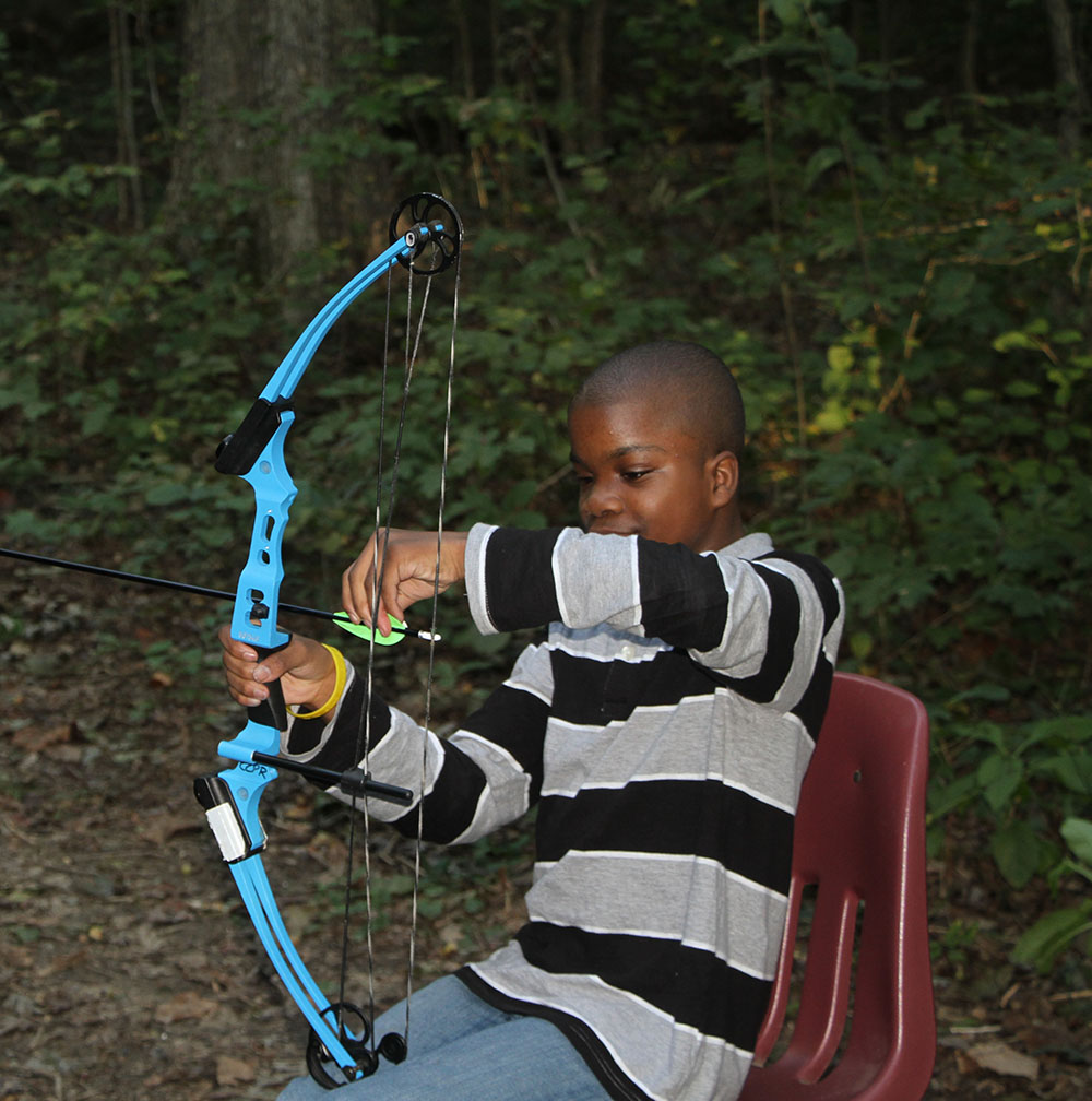 Child playing with a bow and arrow.