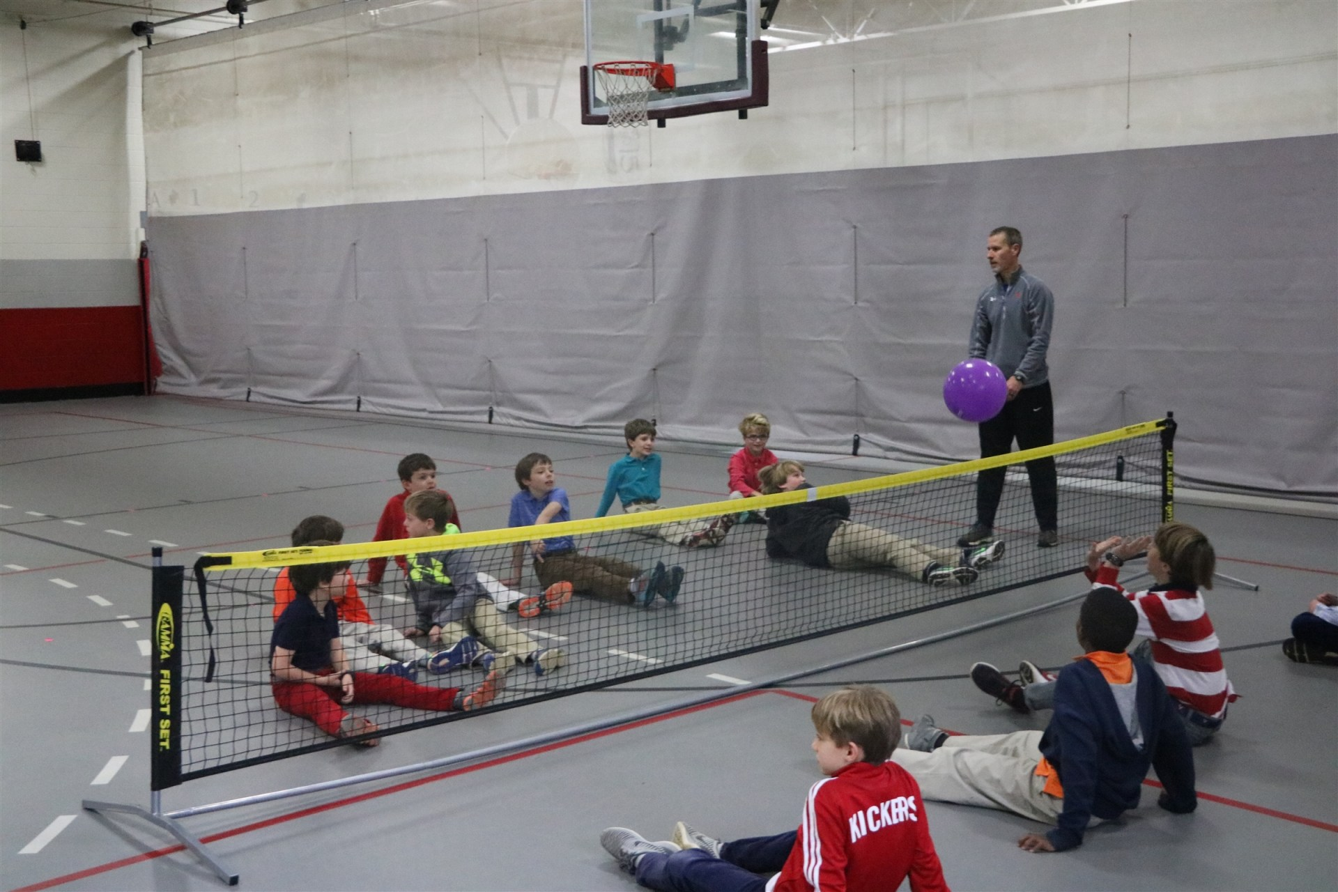 photo of students playing sitting volleyball